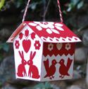 kissin' kritter kabin ornament